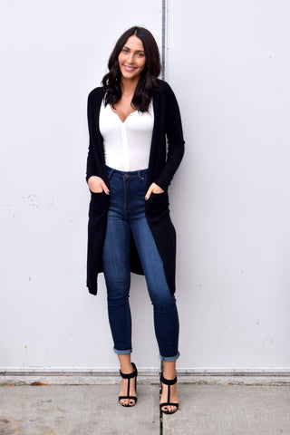 You won't have any trouble keeping up at these prices! This soft and lightweight cardigan is a classic to last all seasons with front pockets, long length and side slits.   50% viscose, 30% polyester, 20% nylon Hand wash cold; dry flat; do not iron Meliha is 5'9 and wearing a small