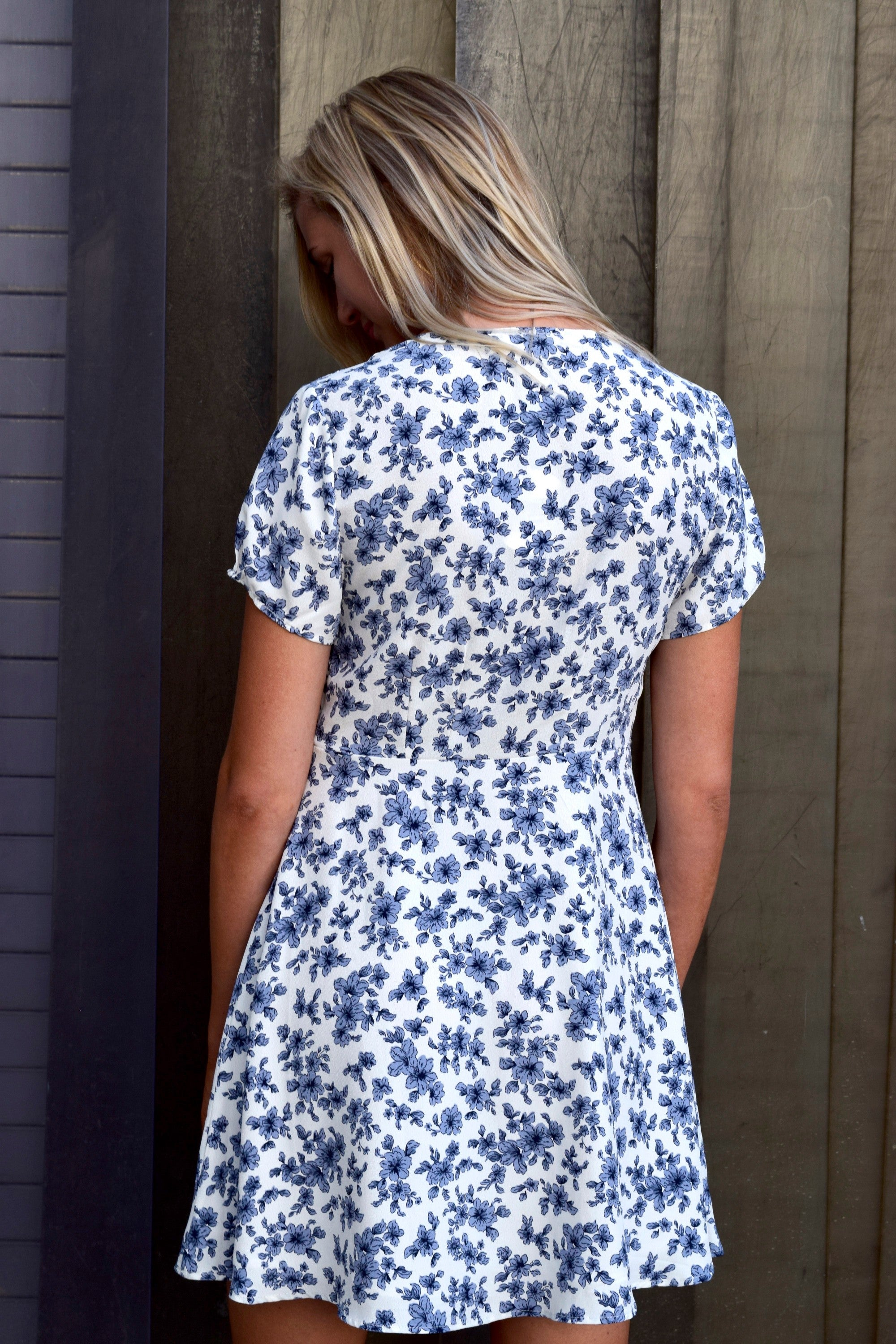 SHE'S A DOLL WHITE AND BLUE FLORAL DRESS