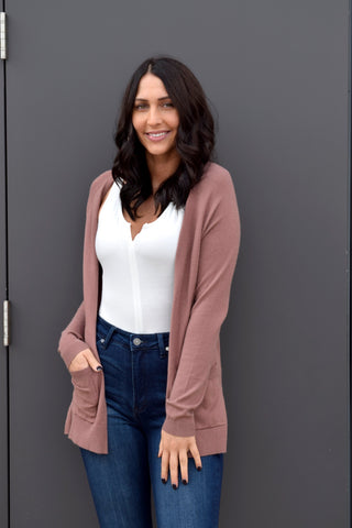 You won't have any trouble keeping up at these prices! This soft and lightweight cardigan is a classic to last all seasons with front pockets and long sleeves.   50% viscose, 30% polyester, 20% nylon Hand wash cold; dry flat Meliha is 5'9 and wearing a size small
