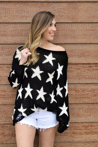 THE STAR ATTRACTION BLACK SWEATER