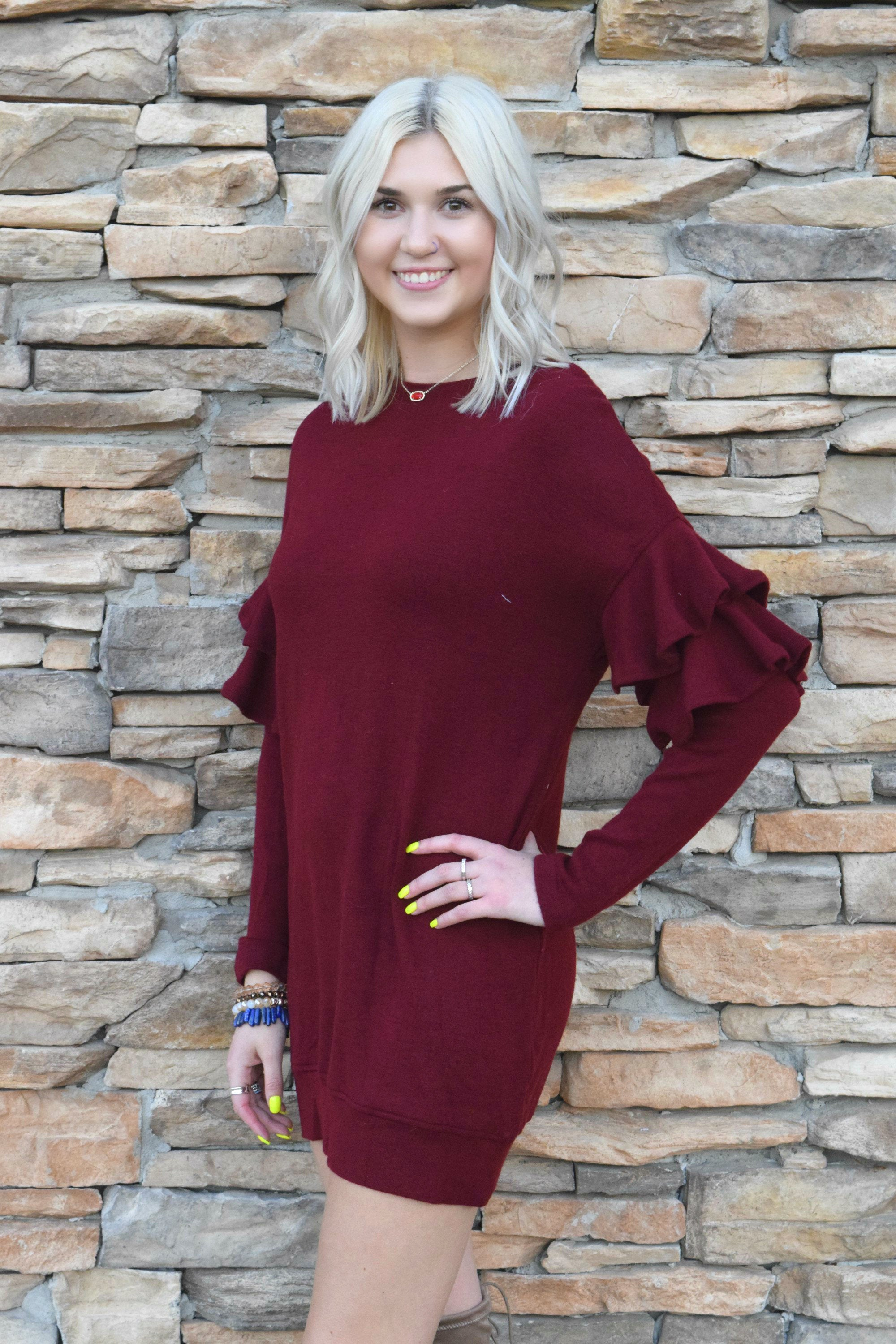 A LITTLE RUFFLE AND TUMBLE WINE SWEATER DRESS