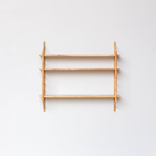 wall hung wooden shelving by John Eadon with three shelves, minimal