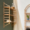 wall hung wooden ladder shelving by John Eadon on living room wall