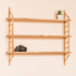 wall hung wooden shelving by John Eadon, angle view with camera
