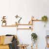 Custom layout of wall hung wooden shelving by John Eadon
