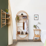 arched freestanding wooden ladder shelving by John Eadon single unit set used as wardrobe