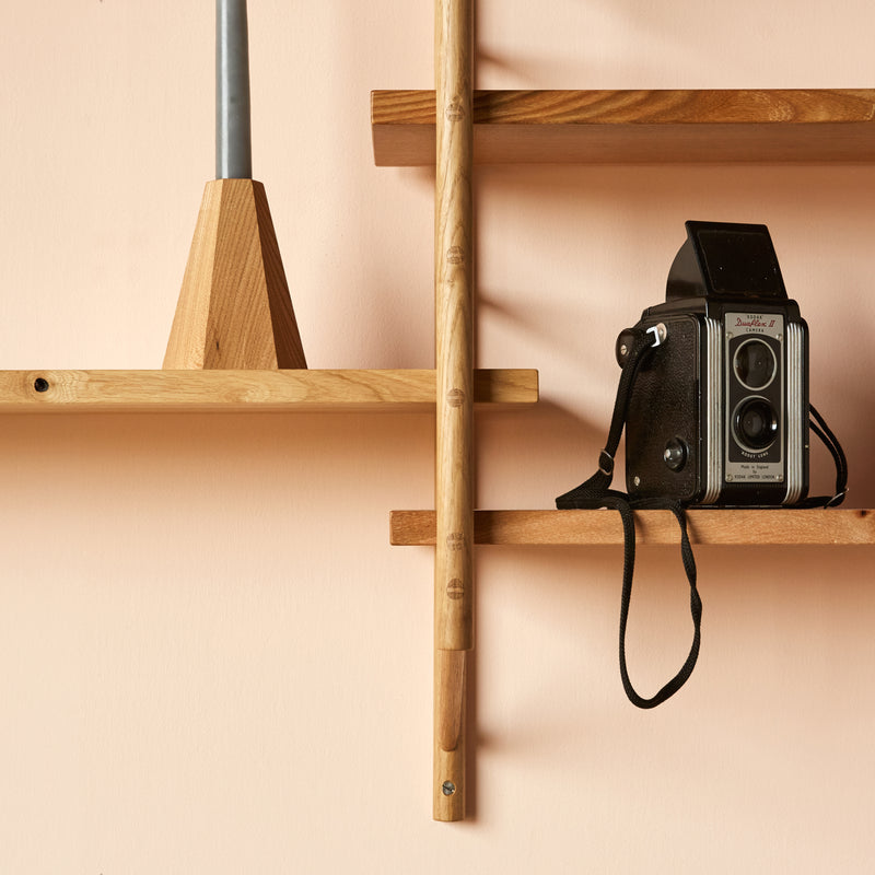 wooden shelving with vintage camera