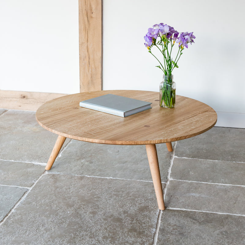Three legged low round coffee table