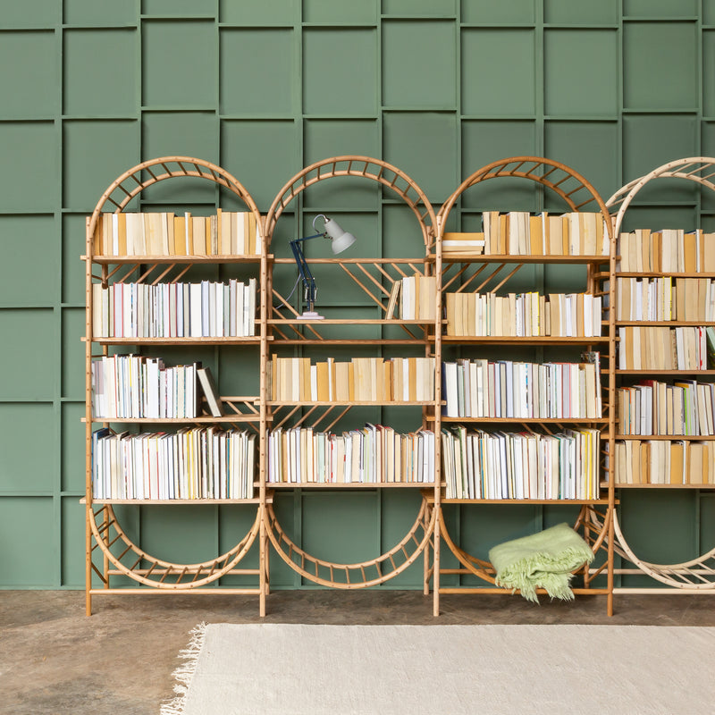 arched freestanding wooden ladder shelving by John Eadon with books