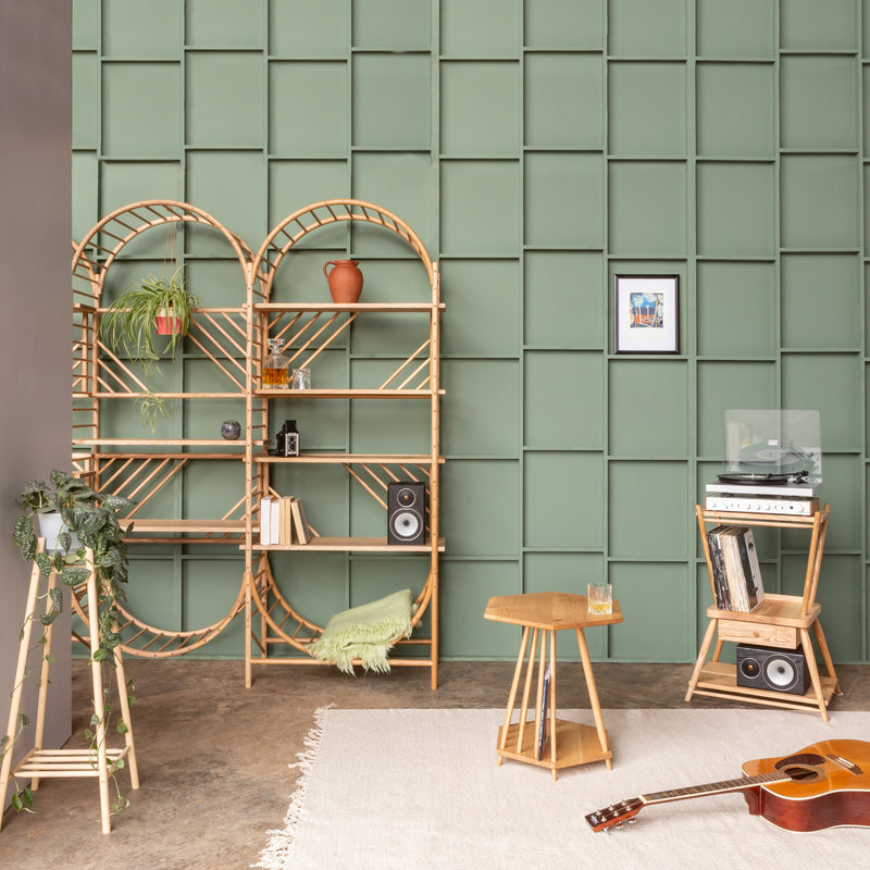 arched freestanding wooden ladder shelving by John Eadon double unit set in room setting with tables and music