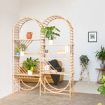arched freestanding wooden ladder shelving by John Eadon used as a room divider