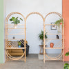 arched freestanding wooden ladder shelving by John Eadon used as a room divider with entrance way arch