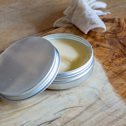 A homemade wood balm wax blended from a selection of natural food safe waxes and oils