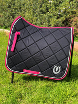 Black dressage pad with hot pink binding