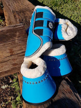 Bright turquoise boots