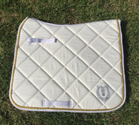 Cream and gold dressage pad