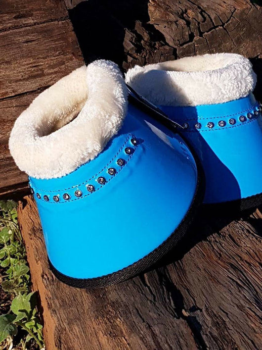 Bright turquoise bell boots