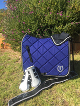 Royal blue dressage pad with black binding