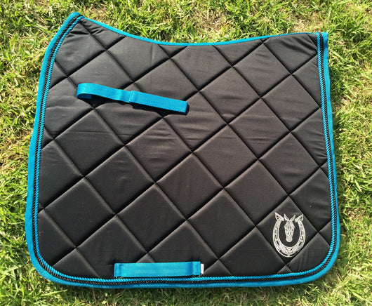 Black dressage pad with turquoise trim
