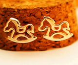 Gold coloured small rocking horse ear studs