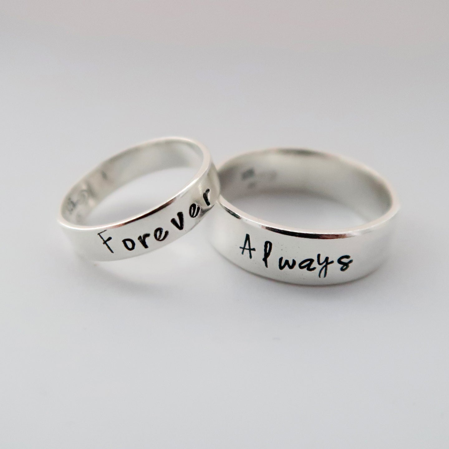 Personalised sterling silver couple rings made in wales uk by elfen hardd