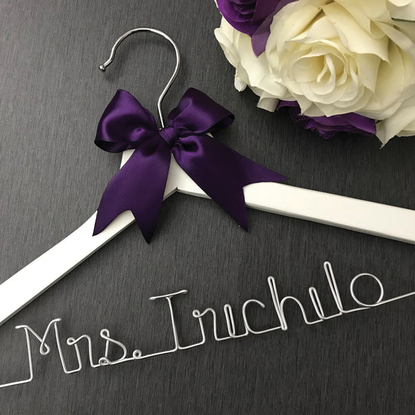 white wedding hanger with purple bow custom wedding hanger