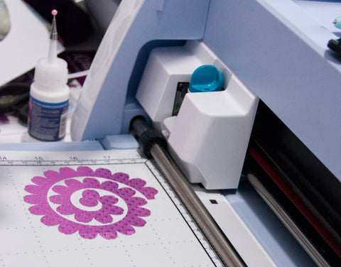Rolled flower cutting file with the fuchsia starstruck foiled paper