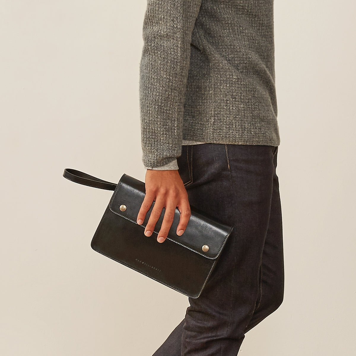 Image 6 of the 'Santino' Black Handmade Veg-Tanned Leather Wrist Bag