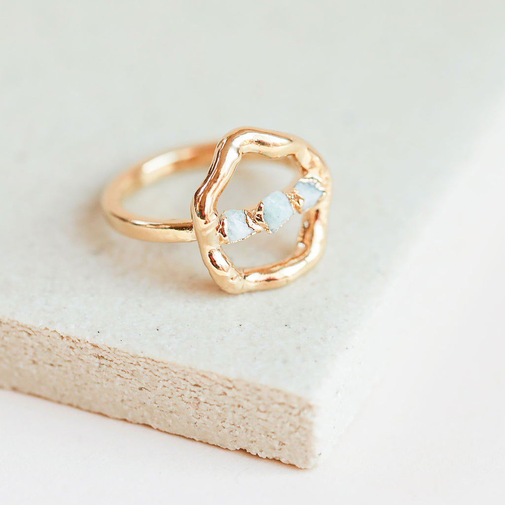 Our raw amazonite halo ring adds instant cool to any outfit.
