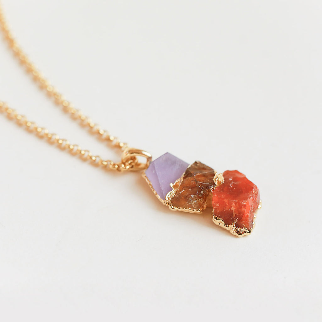 Lavender amethyst, citrine, and striking carnelian crystals form this stunning handcrafted necklace.