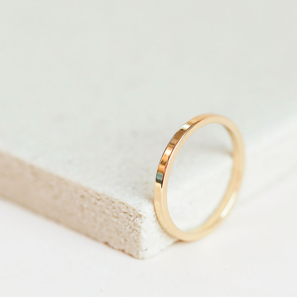 Classic gold band ring for women.