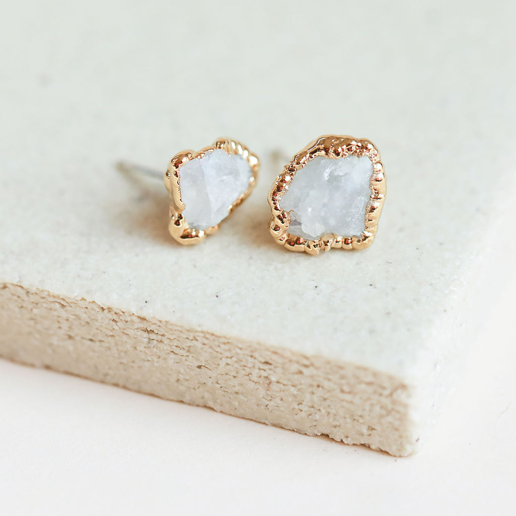 A pair of raw moonstone gold stud earrings that are simple yet stunning.
