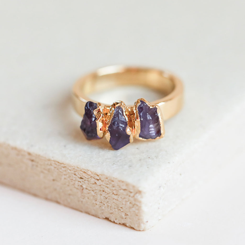 Add a touch of elegance to any outfit by slipping on raw amethyst gold stacking ring.