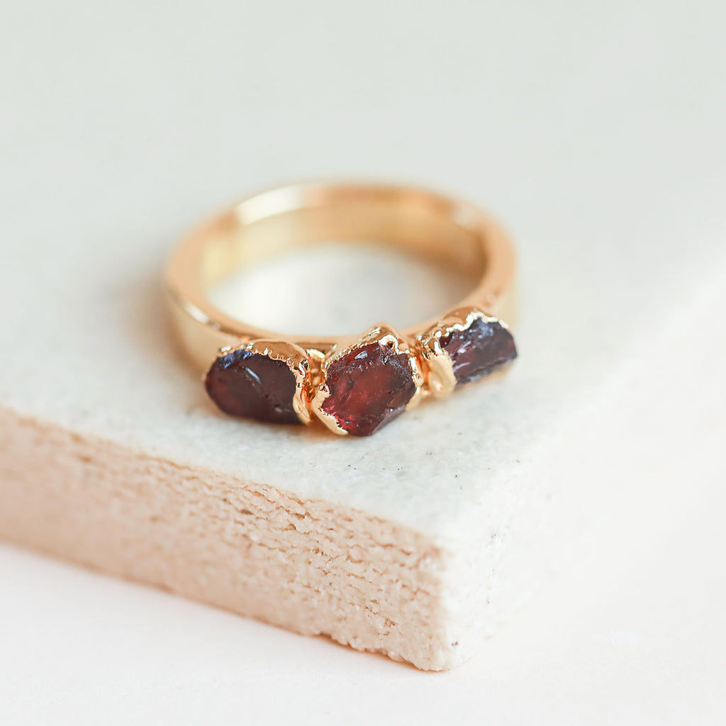 This polished, raw garnet stacking ring is equal parts pretty and earthy. It can be worn as a January birthstone ring, but garnet is also the stone of love & relationships.