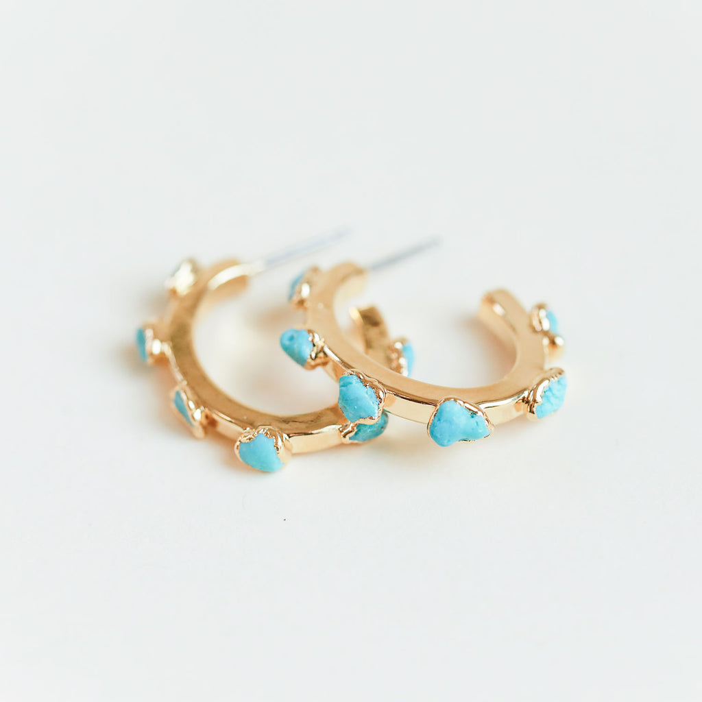 Raw turquoise large gold hoops by Dani Barbe