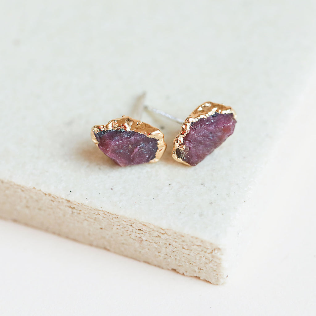 Raw ruby gold studs by Dani Barbe