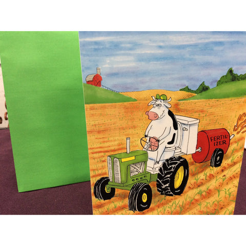 """Cow on Tractor Toilet"" Greeting Card"
