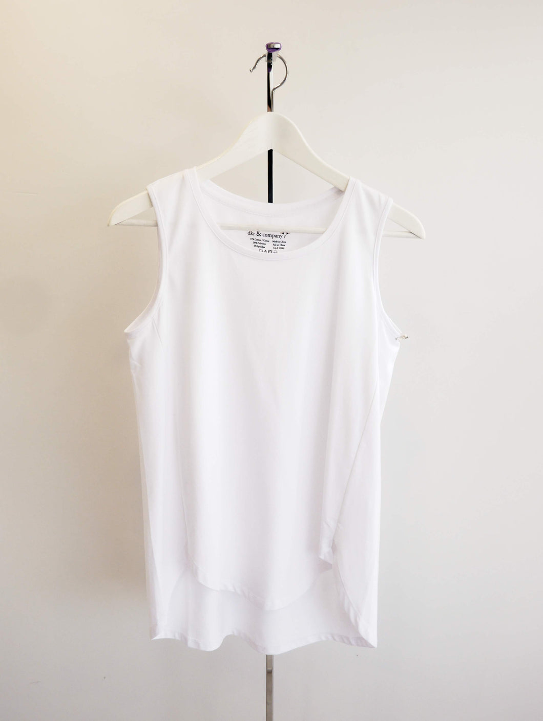 Sleeveless Top with Curved Hem and Back Pleat Detail