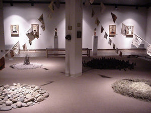 After the Fall. installation. smoke-fired and illuminated clay vessels, ash, stones, straw, four strings of silk-screened prayer flags. Owen Gallery, Asheville NC, 2001.