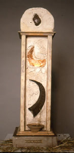 "Male. wood, clay, goat horn, paper, light. 20″x7″x7,"" 2000"