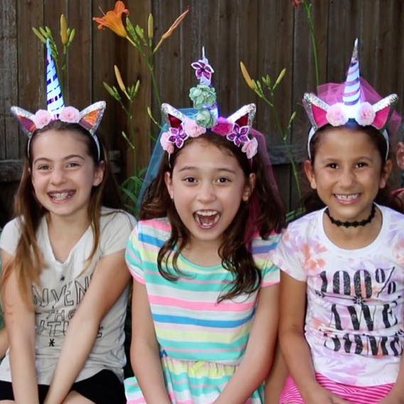Unicorn Headband Workshop birthday party with Light-Up Unicorn headbands.