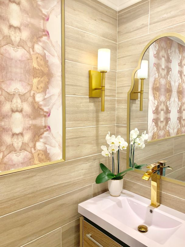 Abstract pink and brass gold wallpaper design in bathroom