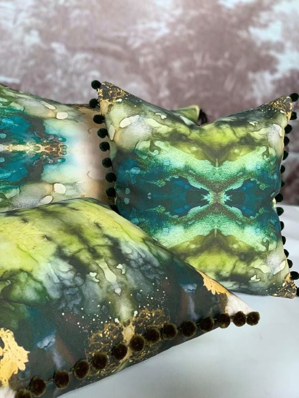 green emerald and jade pillow display in front of vivian ferne wall sticker