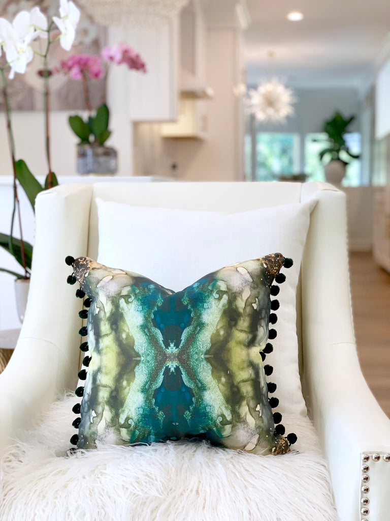 white and gold kitchen, green decor pillow, green living room