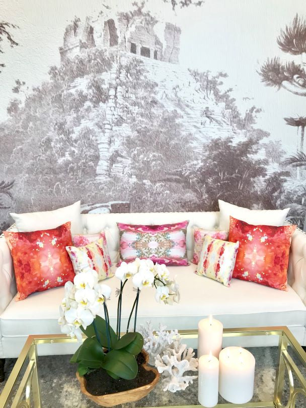 Chichén Itzá wall mural behind white couch with colorful pillows