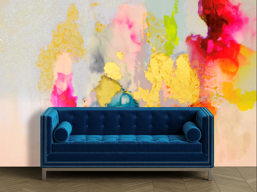 Blue couch in from of a pastel rainbow wall mural