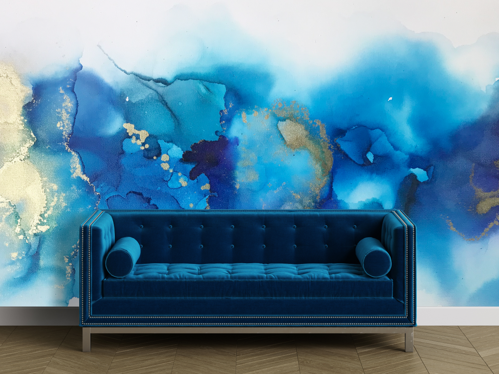 Blue and gold wall mural behind a blue couch