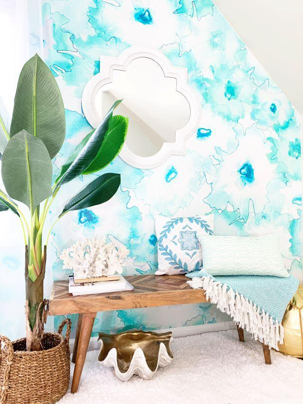 Teal accent wall mural behind bench