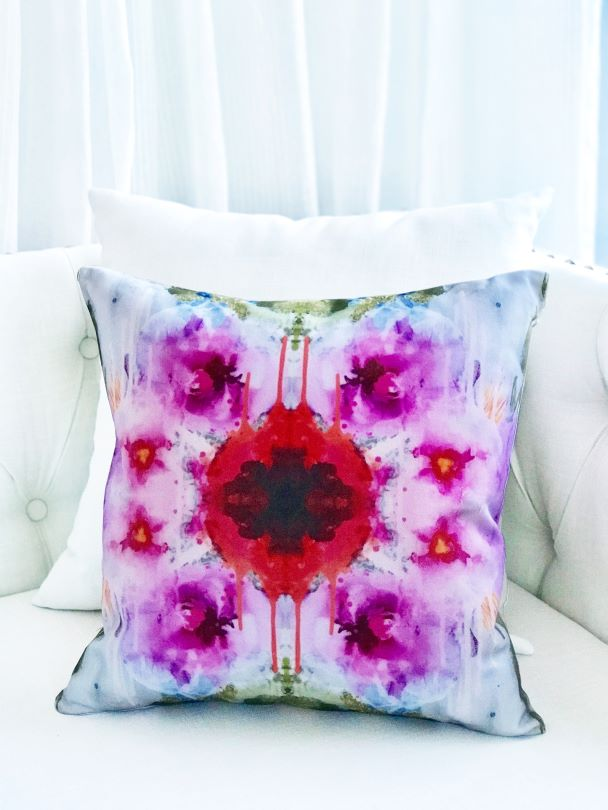 Abstract designer flower pillow on a classic white couch