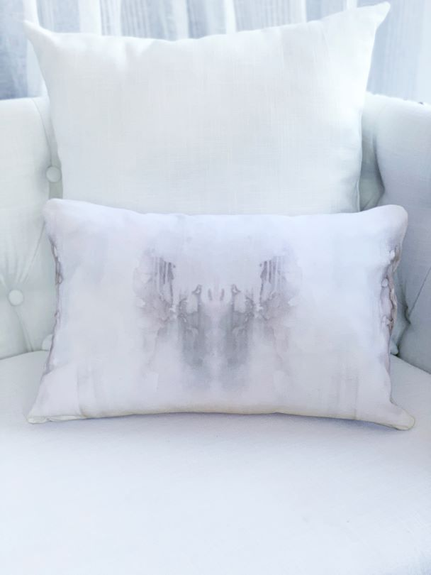 Grey and white lumbar pillow on white sofa